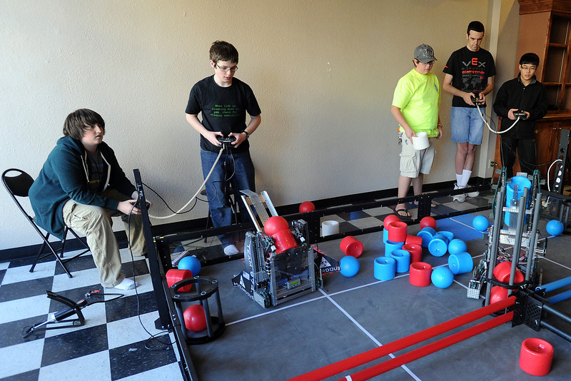 Robotics team players, from left, Mark Stewart, 14, Chase Rayment, 14, John A.C. Miller, 17, Evan Proulx, 16, and Cliff Yang, 17, compete in a scrimmage on a practice field set up in downtown Loveland at 210 E. Fourth St. on Saturday, April 7, 2012.