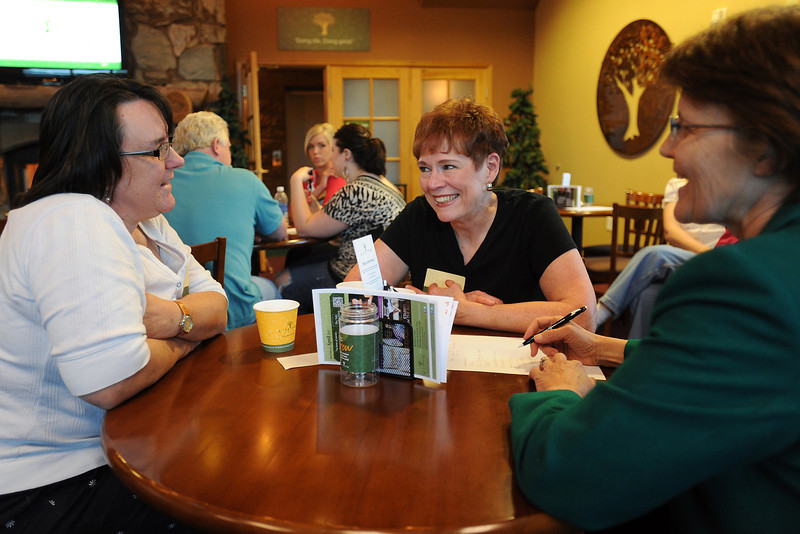 Participants in a Lifetree Cafe event, from left, Kathy Limstrom, Barbara Miller and Laura Stout discuss a topic during a meeting on Tuesday, April 10, 2012 at Group Publishing, 1515 Cascade Ave. in Loveland.