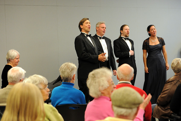 """Members of the Loveland Opera Theatre sing """"Happy Birthday"""" to a visitor at the conclusiof of their performance Friday, April 13, 2012 at the Rialto Theater Center during the Grand Night for the Community event showcasing the theater's recent remodel and addition."""