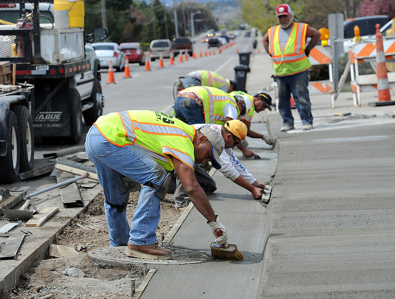 A crew from CG&S work on a new concrete sidewalk and gutter Tuesday on 29th Street near Lake Drive in Loveland. From front to back they are Geno Andrade, Rodney Villegas, Pete Pedro, Joe Romero, Ivan Ortega and Ray Mungia, right. Crews will be working on concrete repairs between Taft Avenue and Garfield Street and replacing a portion of the water line under 29th street between Colorado Avenue and the outlet canal from Lake Loveland. They hope to have the project complete within 60 days.