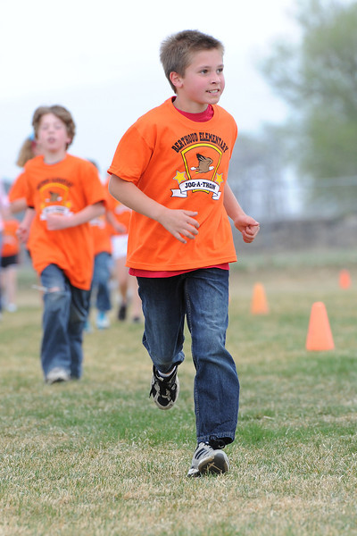 Berthoud Elementary School fourth-grader Logan Kilgroe runs along with his classmates during the Jog-a-thon outside the school on Wednesday, April 11, 2012.