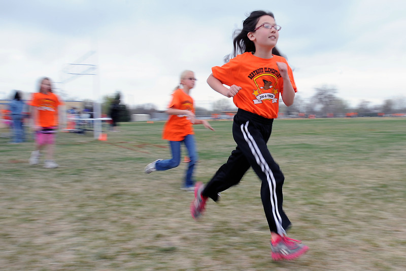 Berthoud Elementary School fourth-grader Delaney Stinn runs during the Jog-a-thon outside the school on Wednesday, April 11, 2012.