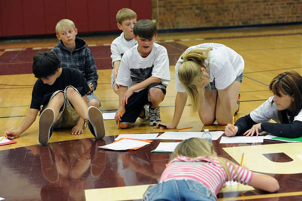 A group from Turner Middle School works together during an action planning session about school safety and bullying on Tuesday, April 17, 2012 at Berthoud High School as part of a youth leadership conference. At bottom front is Maddie Rusk, 13, and back from left are Chris DeSousa, 12, Wyatt Stratmeyer, 12, Evan Poll, 12, Ben Hardy, 12, Kate Bender, 13, and TMS assistant principal Christine Smith.
