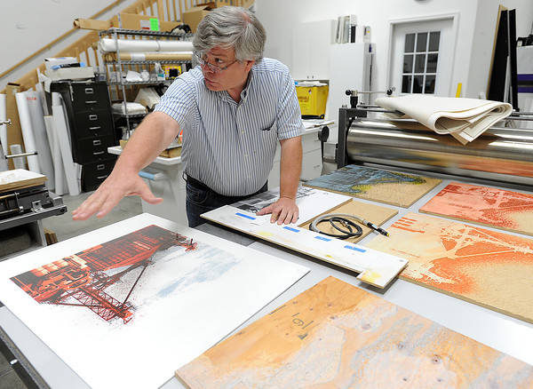 Dean Russell Thompson explains the wood cutting process to design an artistic print. Each color is cut individually and then registered onto paper and run through a press. Thompson is one of many artists who will be featured in the Governor's Invitational Art Show and Sale.