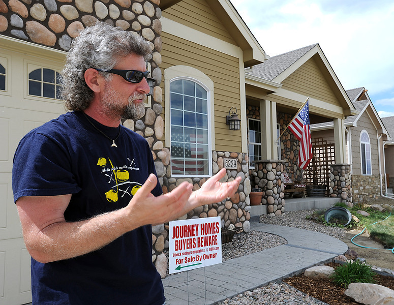 Standing in front of his Loveland home, Anthony DeTomasi, a resident in the Taft Farms neighborhood, talks Thursday about how he other residents in the subdivision are worried about lower-priced offerings being built in their higher-end neighborhood.