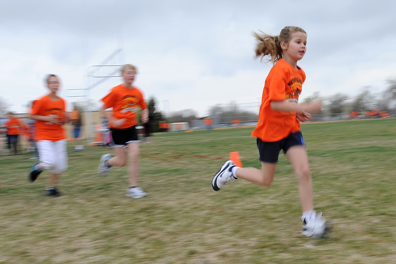 Berthoud Elementary School fourth-grader Olivia Dunn, right, runs along with her classmates during the Jog-a-thon outside the school on Wednesday, April 11, 2012.