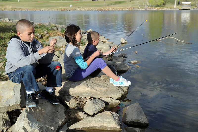 Anthony Rodriguez, 9, left, readies his fishing pole while fishing with his sister Olivia, 11, and brother Jesse, 6, on Thursday, April 19, 2012 at North Lake Park. The siblings are from Cheynne, Wyo. and were in Loveland visiting their grandmother Terrie Chiquito.