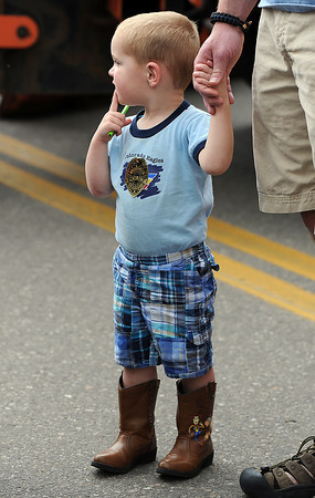 Thomas Williams Jr., 2, tries to decide which activity to try next during Children's Day.