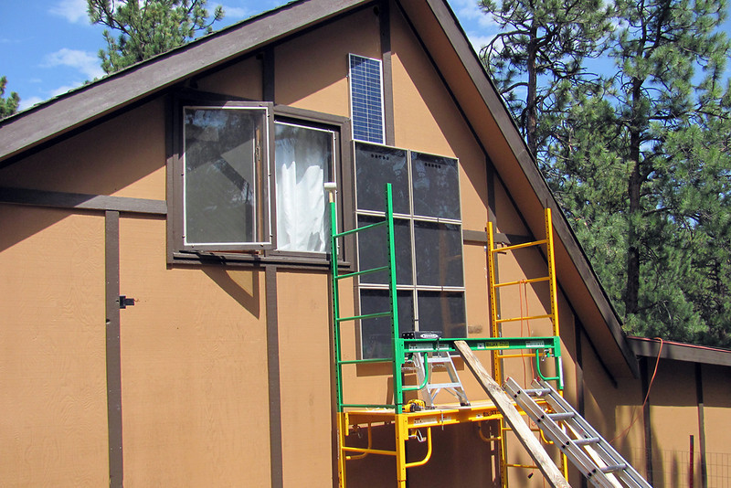 Susan Bloomquist said she loves the six-panel CozyTherm system that she had installed on the work room at her home in the mountains west of Boulder. (Photo courtesy of Gary DuChateau)