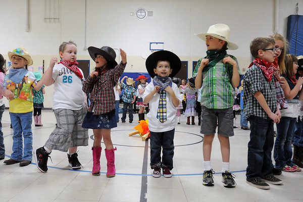 Youngsters sing a song together during Namaqua Elementary School's kindergarten rodeo on Friday, April 26, 2013.