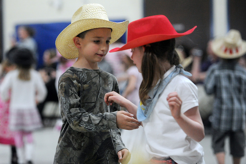 Cole McDonough, 6, left, and Araleya Kemp, 6, dance together during Namaqua Elementary School's kindergarten rodeo on Friday, April 26, 2013 in the school's gymnasium.