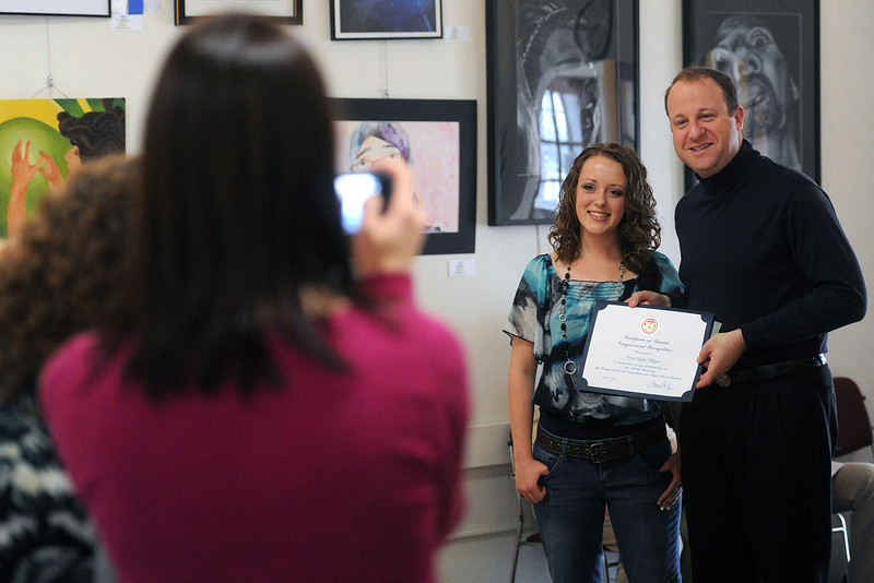 Loveland High School sophomore Cosette Klingler, 16, middle, poses for a picture with Rep. Jared Polis, right, during the 2nd Congressional District Art Show on Saturday, April 20, 2013 at the Wildfire Community Arts Center in Berthoud.
