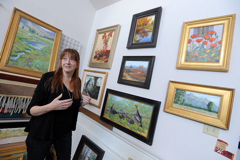 Loveland artist Patti Andre talks about some of her paintings at her studio in Loveland on Thursday, April 18, 2013. She is one of many artists that will be featured in the upcoming Governor's Art Show at the Loveland Museum and Gallery.