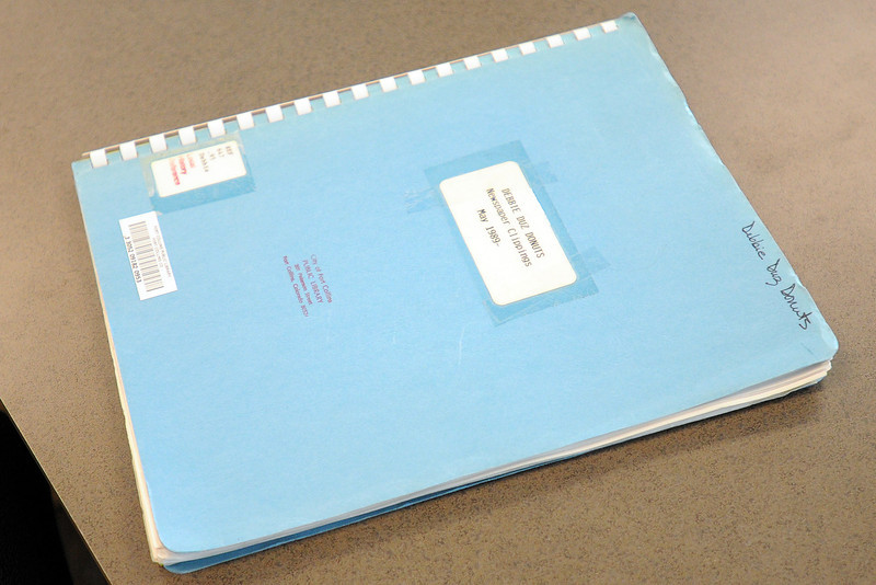 A notebook containing newspaper clippings pertaining to the Fort Collins business Debbie Duz Donuts that was in operation in 1989 is part of the collection at the Museum of Discovery.