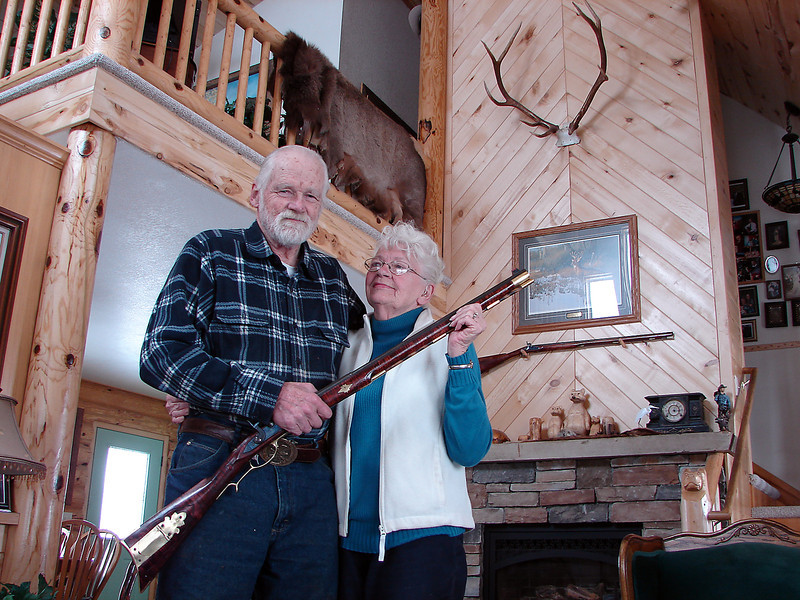 Ray Ezinga holds a 60-caliber muzzle-loading rifle on Tuesday, April 16, 2013. It is one of many he has built since his first in 1950, with his wife, Jean, at their Loveland home on the west shore of Horseshoe Lake.