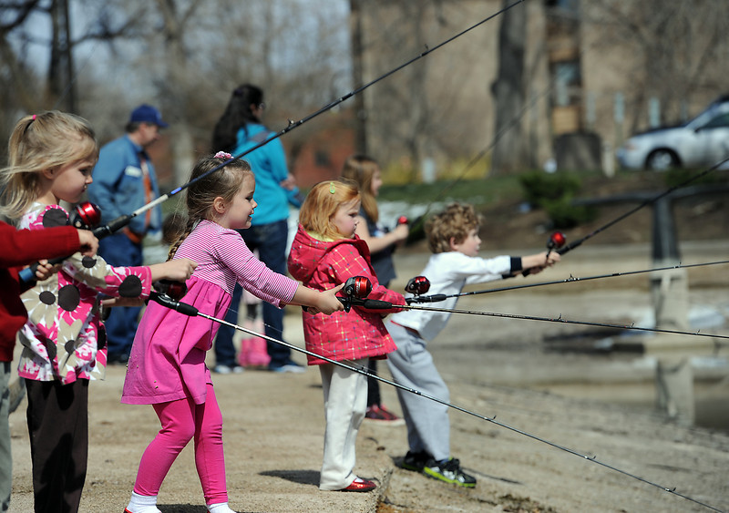 Children cast their fishing poles into Foote Lagoon during Children's Day in Loveland on Wednesday, April 24, 2013. From left are Cora Cox, 5, Martha Simpson, 4, Kathryn Cox, 4, and Jacob Simpson, 6.