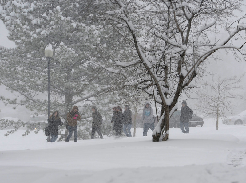 Loveland High School students walk through the snow in Loveland on Monday, April 15, 2013.