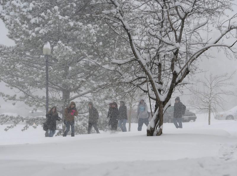 Loveland High School students walk through the snow in Loveland on Monday, April 15, 2013.