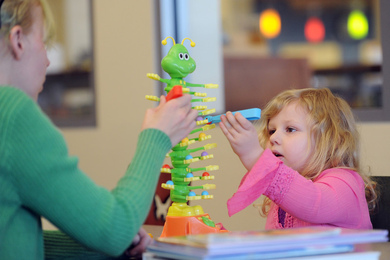 "Terin Wilson, left, and her daughter Bellatrix, 3, play a game together called Catterpillar Scramble on Thursday, April 4, 2013 in Mrs. Runschmunkel's Reading Room at the Loveland Public Library. The library has a number of activities scheduled over spring break including a quilling (ancient art of paper rolling) for kids 7-and from 2-3 p.m. on Friday and a ""Cogs & Clockwork"" LEGO workshop from 1-4 p.m. on Saturday in the children's section. For teens there will be Ultimate Gaming from 3:30-5:30 p.m. on Friday in the teenseen."