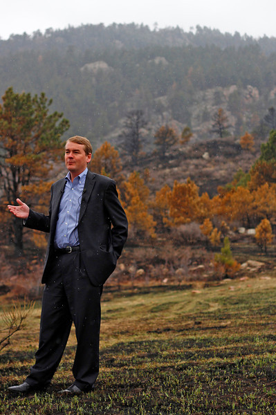 U.S. Sen. Michael Bennet stands on charred ground within the Galena fire zone at Lory State Park Tuesday morning while speaking about the bill he's introducing to promote forest health and fire prevention.