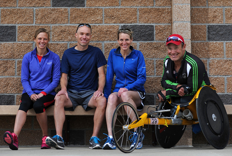 Loveland residents, from left, Nicole Fellure, Adam Morgan, Amy Hallagan, and Brad Ray pose for a picture at Loveland Sports Park, Monday, April 8. All four will be participating in the Boston Marathon this upcoming Monday.