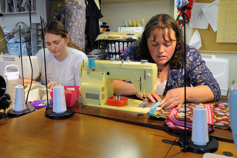 Ashley Kelsay, left, and Jessica Kistler work on sewing projects Wednesday, April 10, 2013 at the Rip Club sewing lounge located at 333 N. Cleveland Ave. in downtown Loveland.