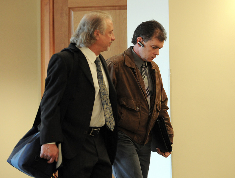 Former Loveland Police officer Rod Bretches, right, walks out of a court room with his attorney, Jonathan Willett, at the Larimer County Justice Center in Fort Collins on Monday, April 8, 2013. Bretches pleaded not guilty to allegations of possessing child pornography and secretly recording a woman in the shower.