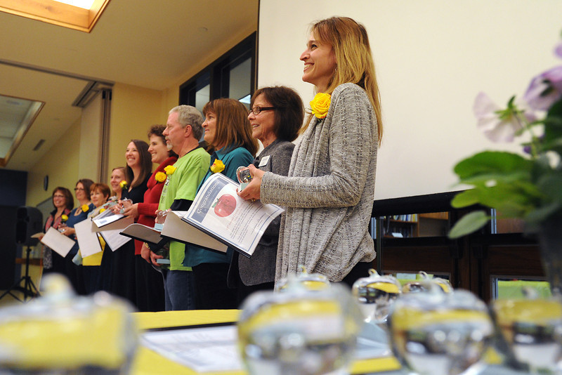 Coyote Ridge Elementary School second-grade teacher Stephanie Jepson, right, stands with other elementary school teachers who were received awards during the Crystal Apple Awards ceremony Friday, April 19, 2013 at the Chilson Senior Center.