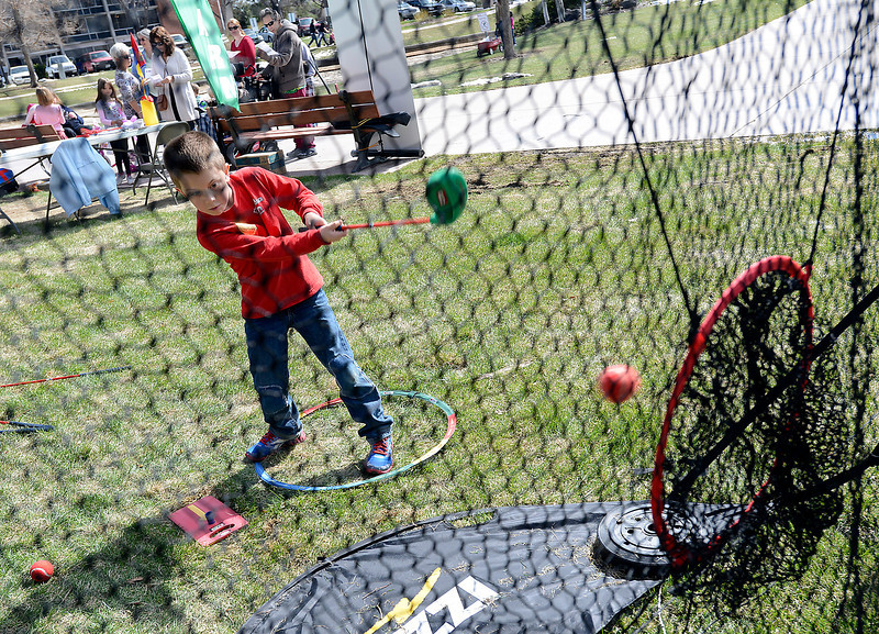 Weston Bockelmann, 6, hits a ball into a net while learning about SNAG golf during Children's Day in Loveland on Wednesday, April 24, 2013.