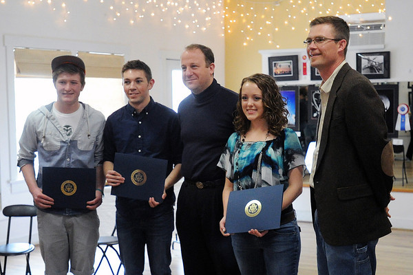Rep. Jared Polis, center, poses with Loveland High School students, from left, Bailey Entner, 17, Travis Collins, 17, and Cosette Klingler, 16, and LHS art teacher Brian Causer after presenting the students with awards during the 2nd Congressional District Art Show on Saturday, April 20, 2013 at the Wildfire Community Arts Center in Berthoud.