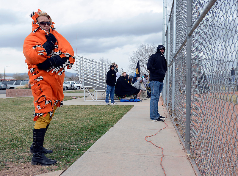 All bundled up with a blanker in the cold wind, Julie Smith watches her son, Garrett Smith, play baseball during the Thompson Valley vs. Loveland baseball game at Swift Field at Centennial Park in Loveland on Monday, April 8, 2013.