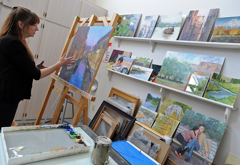 Loveland artist Patti Andre talks about a painting she is working on at her studio in Loveland on Thursday, April 18, 2013. She is one of many artists that will be featured in the upcoming Governor's Art Show at the Loveland Museum and Gallery.