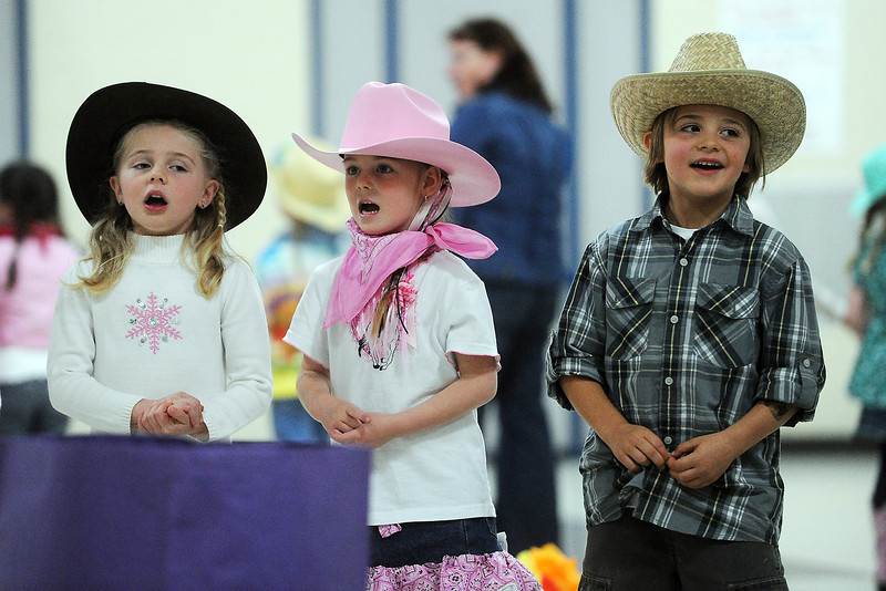 Namaqua Elementary School kindergartners Cody Miner, 5, left, Taryn Harris, 5, and Evan Raabe, 5, sing a song along with their classmates during the kindergarten rodeo on Friday, April 26, 2013.