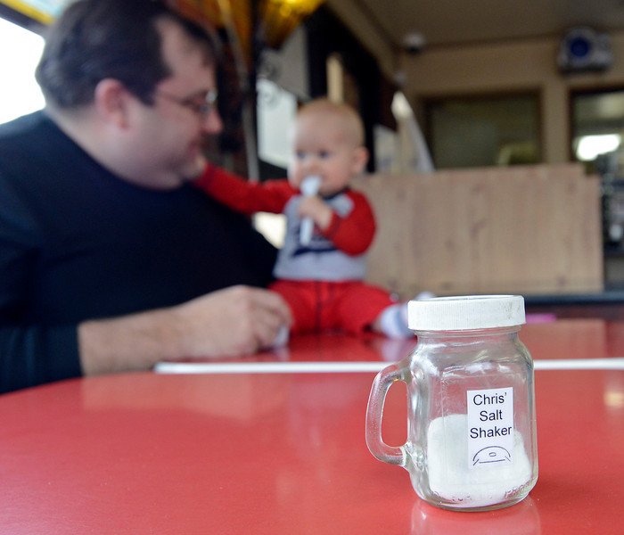 Chris Steffen is such a regular customer at Dairy Delight in west Loveland that he even has his own salt shaker at the ice cream shop and family diner. Steffen plays with William Bradford, 8 months, while he waits for his food on Tuesday, April 2, 2013. William is the grandson of Dairy Delight owners, Mike and Pat Embke.