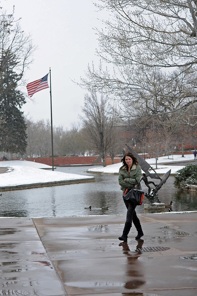 Loveland resident Audrey Johnson walks through Civic Center Park Tuesday, on her way to the Chilson Recreation Center. The snowy conditions don't hamper Johnson, as she has come to expect this weather on the front range.