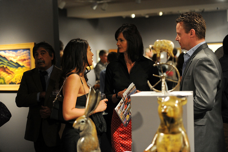 Loveland-based sculptor Joshua Tobey, right, and his wife Josephine Tobey, front left, chat with Marcie Erion near several examples of Joshua's contemporary wildlife sculptures during the Colorado Governor's Invitaional Art Show and Sale opening night gala at the Loveland Museum/Gallery.