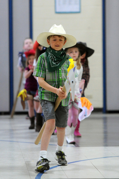 Namaqua Elementary School kindergartner Tom Mandeville, 6, rides his stick horse during the school's kindergarten rodeo on Friday, April 26, 2013.