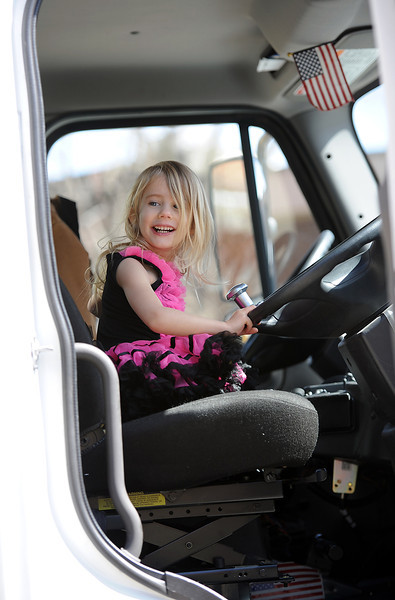 Sporting a tutu, Hannah Fritz, 3, sits behing the wheel of a street sweeper during Children's Day in Loveland on Wednesday, April 24, 2013.