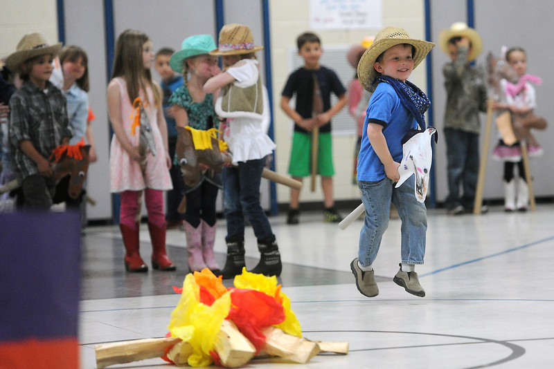 Six-year-old Jack Dickinson rides on his stick horse named Ranger during the kindergarten rodeo on Friday, April 26, 2013 at Namaqua Elementary School. Youngsters dressed up in western wear, danced and sang songs to an audience of their parents and teachers in the school's gymnasium.