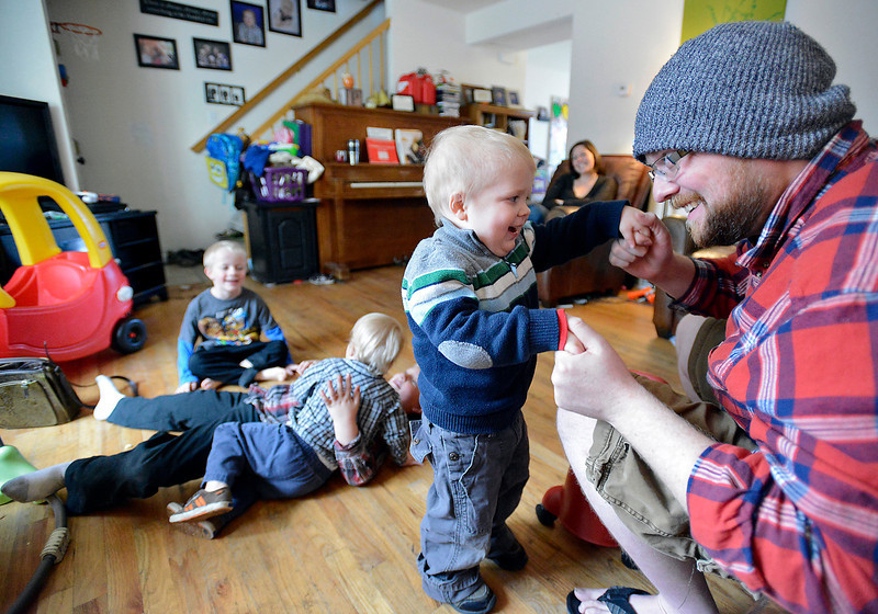 Joel Green, 4, center, dances with his dad, Ryan Green, as his mom, Amy Green watches while his bothers play in the background at their Loveland home on Thursday, April 11, 2013. From top his brothers are Isaac, 5, Elijah, 2, and Caleb, 7. Joel is going through treatment for cancerous tumors all over his body. He recently started dancing, which is a developmental milestone. Joel's family consider him to be a miracle because he has overcome 7 tumors.