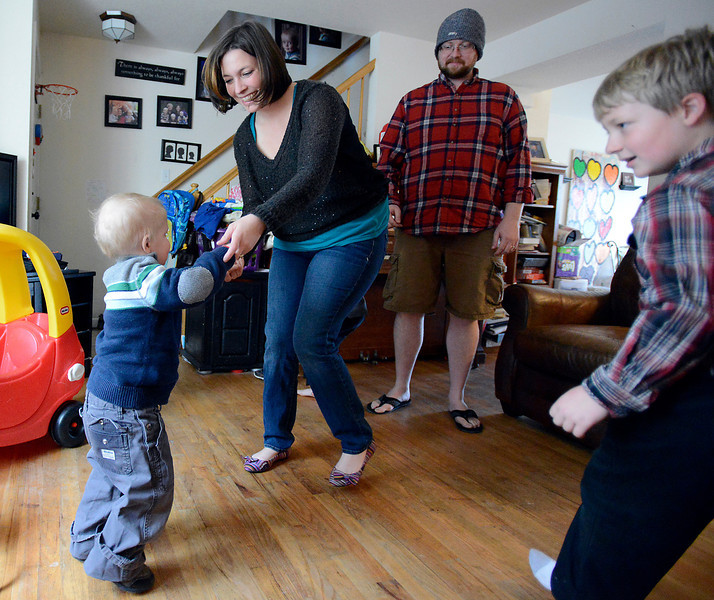 Amy Green dances with her son, Joel, 4, as brother Caleb, 7, and dad, Rayn watch.