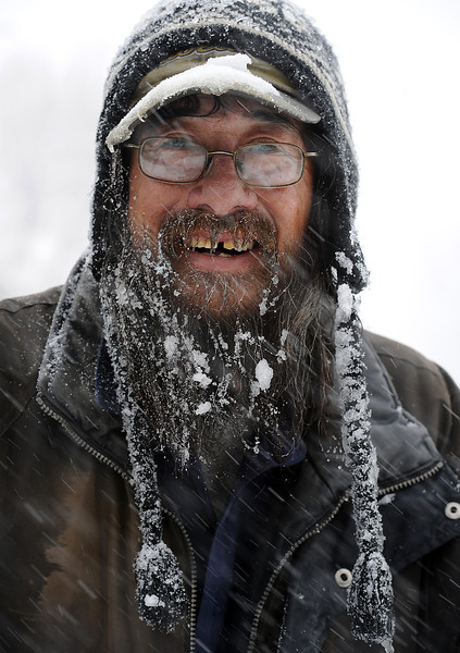Snow sticks to Dan Woelfle's beard and hat in north Loveland on Monday, April 15, 2013.