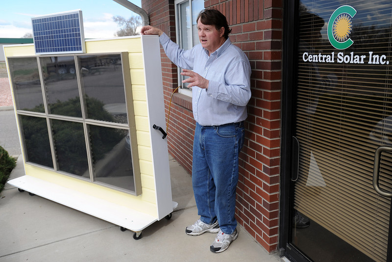 Loveland artist Gary DuChateau stands next to a demonstration model of the CozyTherm modular solar heating system he invented as he talks about its features on April 5, 2013 outside his studio.