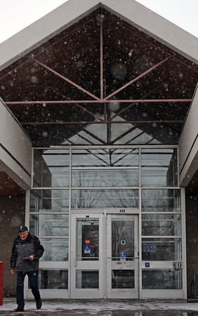 Loveland resident Larry McDonald leaves the post office ,Tuesday, during a snowstorm in Loveland, Colo. McDonald likes the snow, citing Colorado's need for any moisture.