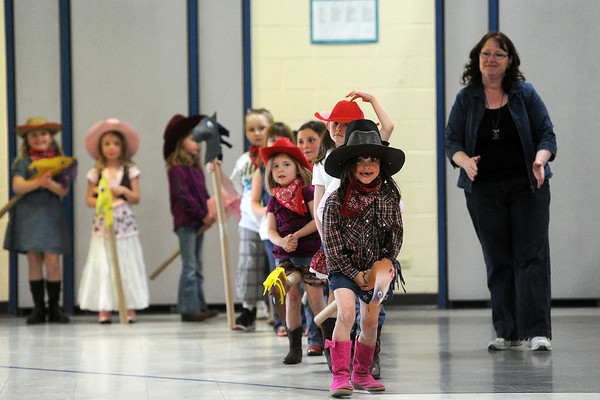 Dakota Spoon, 6, front, rides her stick horse during Namaqua Elementary School's kindergarten rodeo on Friday, April 26, 2013.