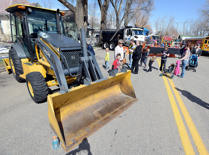 Children check out heavy equipment during Children's Day in Loveland on Wednesday, April 24, 2013.
