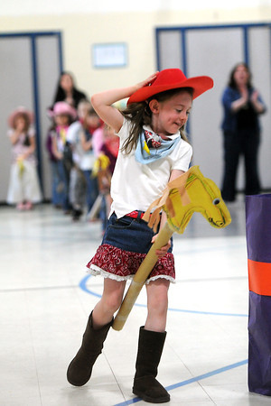 Namaqua Elementary School kindergartner Araleya Kemp, 6, rides her stick horse at the beginning of the kindergarten rodeo on Friday, April 26, 2013.