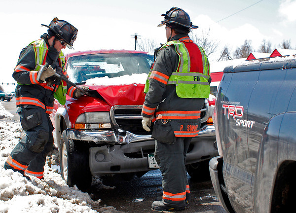 Firefighters work the scene at an accident on Lincoln Avenue, just north of East 16th Street, Tuesday, April 23, 2013, in Loveland, Colo. There were no injuries on scene as the accident was described by one officer as a minor fender bender.