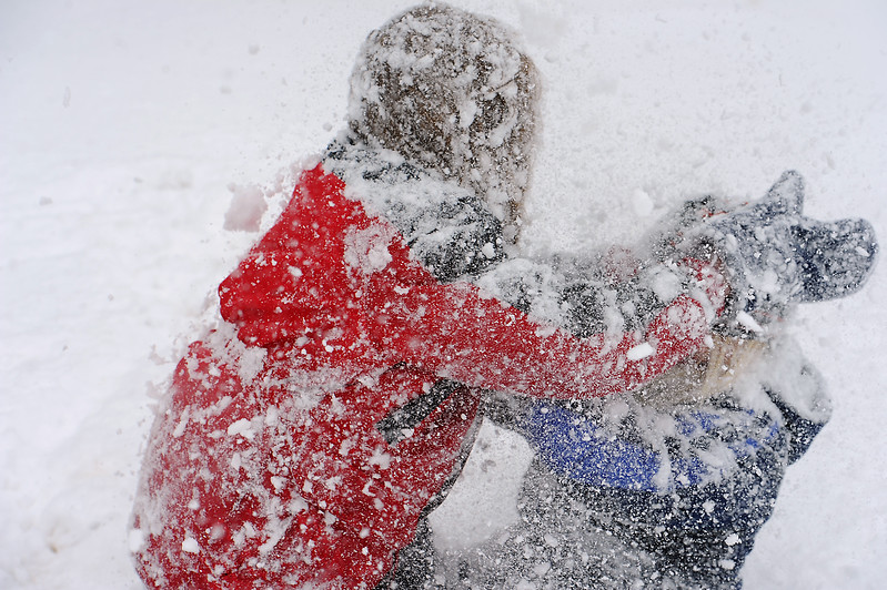 Brothers Storm Downing, 7, left, and Zion Downing, 5, have a snow fight Wednesday at North Lake Park.