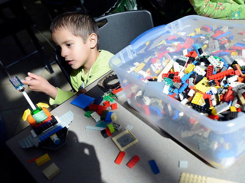 David Loya, 4, checks out a piece built from legos at the Chilson Recreation Center during Children's Day in Loveland on Wednesday, April 24, 2013.